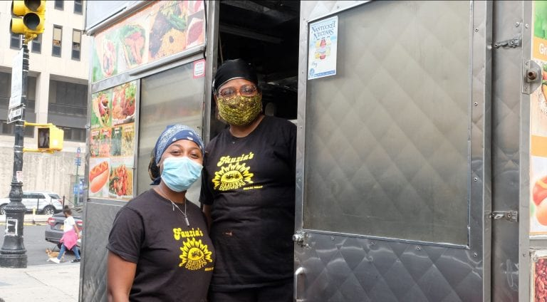 Photo of two women standing in a food truck